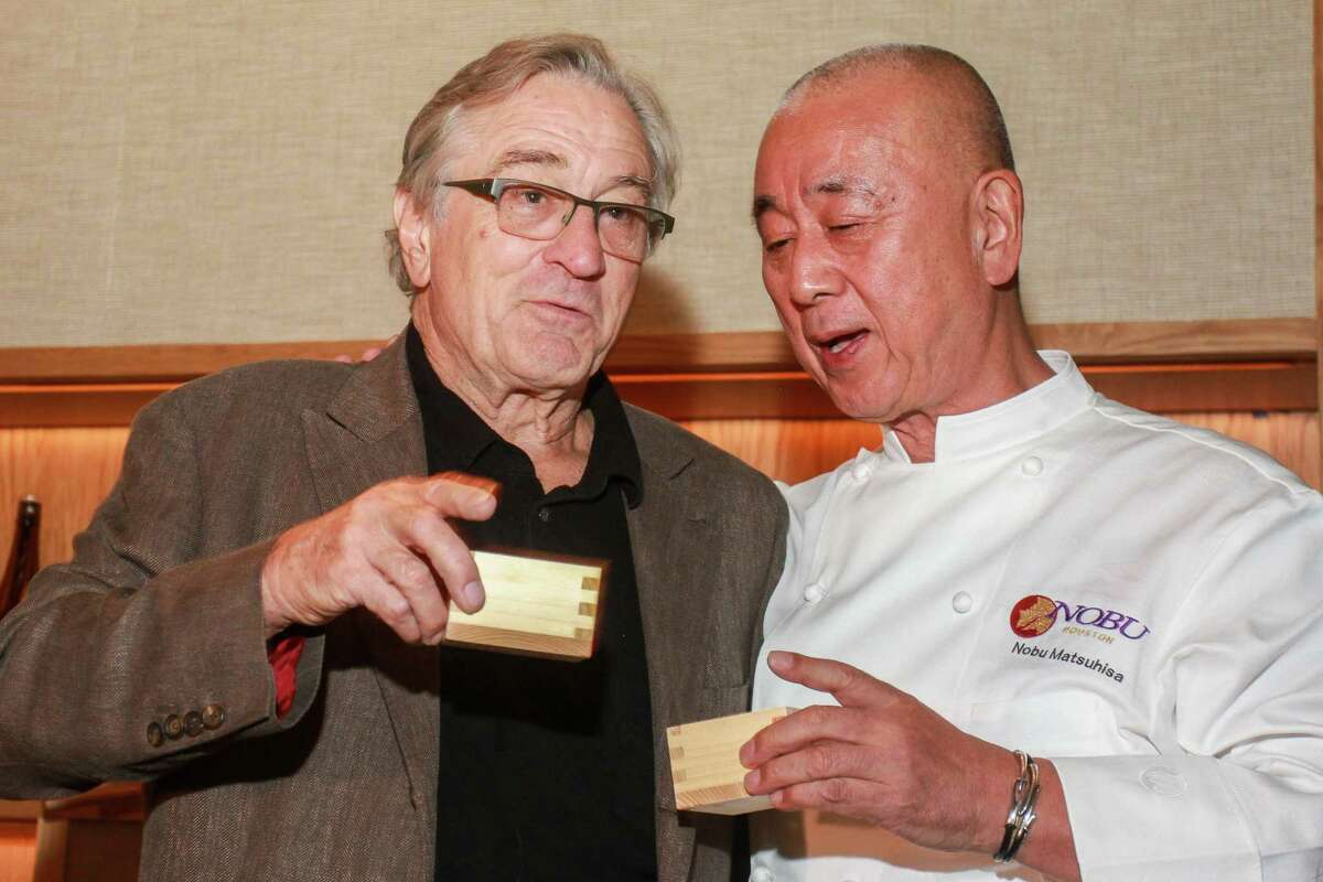 Robert De Niro, left, and Nobu Matsuhisa after the sake ceremony at Nobu Houston during the official grand opening.