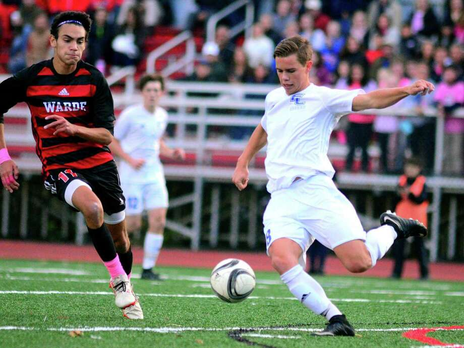 Warde's Daniel Villalba looks to defend against Ludlowe's Kyle Mazza during action Wednesday at Tetreau-Davis Field. The Falcons and Mustangs played to a 0-0 tie. Photo: Christian Abraham / Hearst Connecticut Media / Connecticut Post