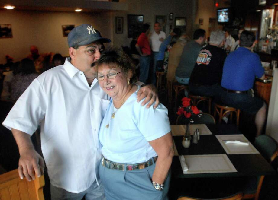 In this 2008 photo, Michael Ippolito gives his mother Bett Ippolito a kiss on their last day at the River Restaurant in Derby. Photo: File Photo