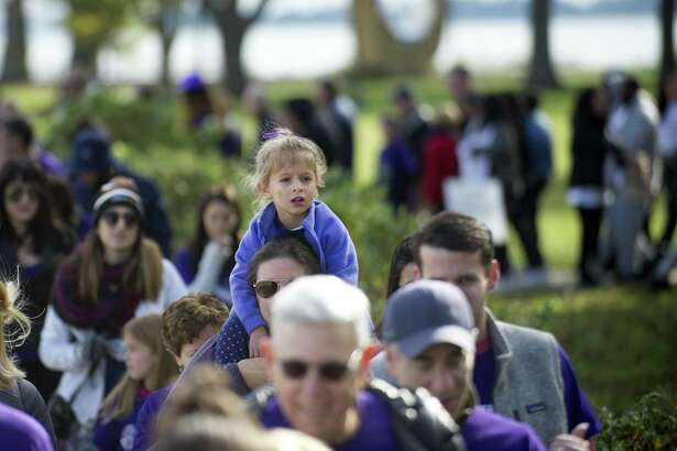 Four-year-old Nicole Cioffi, of Fairfield, sits on her aunt Emily Sciascia's shoulders during the 2018 Walk to End Lupus Now at Calf Pasture Beach in Norwalk on Oct. 14.