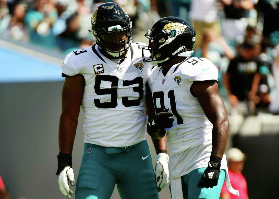 PHOTOS: John McClain's 2018 Week 7 predictions JACKSONVILLE, FL - SEPTEMBER 23:  Calais Campbell #93 and Yannick Ngakoue #91 of the Jacksonville Jaguars celebrate a sack during their game against the Tennessee Titans at TIAA Bank Field on September 23, 2018 in Jacksonville, Florida. Photo: Julio Aguilar, Getty Images / 2018 Getty Images