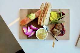"""Community members have influenced the dishes served at Seattle's Freya Cafe, such as the """"Mormor's Pantry,"""" which includes juniper-smoked salmon and house-pickled vegetables."""