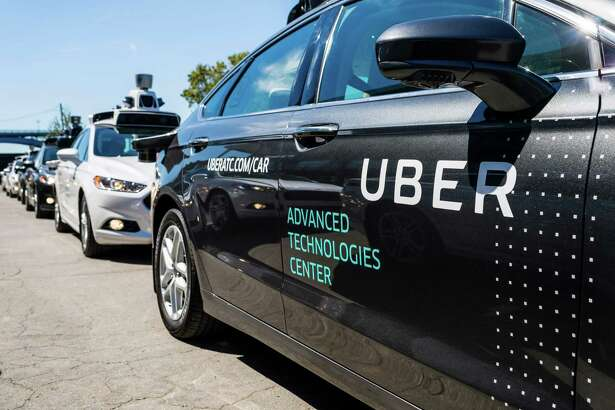 Pilot models of the Uber self-driving car are displayed at the Uber Advanced Technologies Center in Pittsburgh.