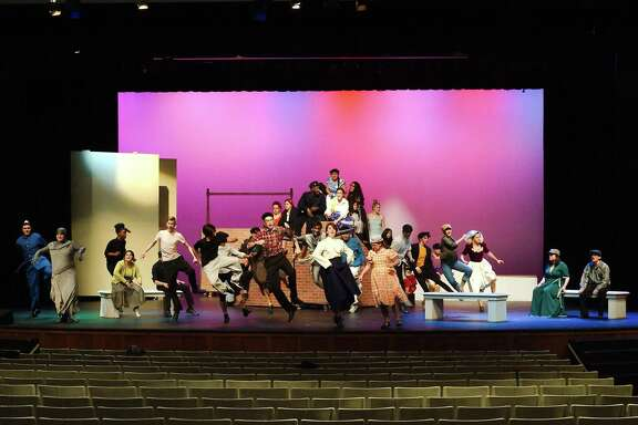 """David McKnight of Pearland, center, shows his moves in dance numbers that are part of San Jacinto Community College's production of """"Mary Poppins."""""""