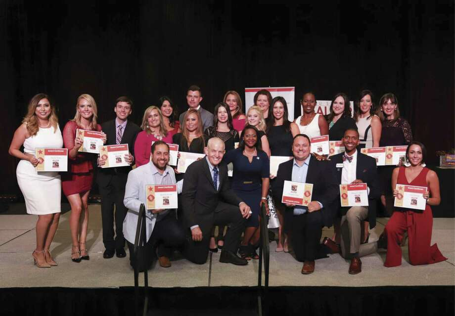 "The Houston Association of Realtors honored its 2018 Young Professionals Network (YPN) 20 Under 40 Rising Stars in Real Estate during ceremonies at the Bayou City Event Center on Oct. 4, with awards presented by keynote speaker Jim ""Mattress Mack"" McIngvale (front row, second from left) and HAR chair Kenya Burrell-VanWormer (front row, center). The 20 winners were selected from a competitive field of entries and were recognized for excellence in sales, leadership and community service."