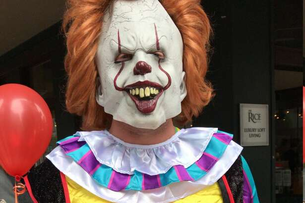 Hurts Donuts Katy General Manager Matt Whitney donned a scary clown costume Thursday, Oct. 18, 2018  to make deliveries to unsuspecting Houstonians in Downtown.