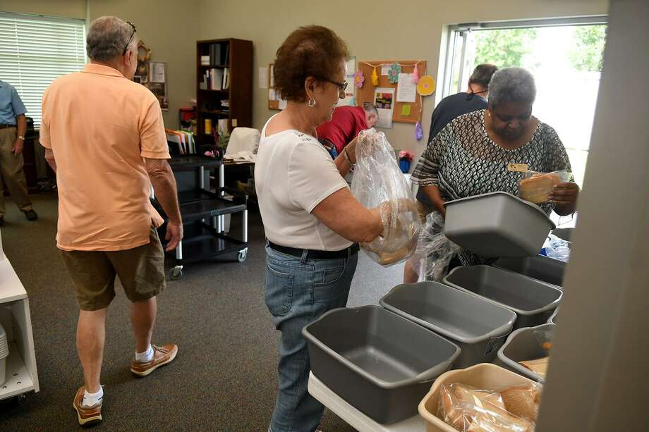Northwest Assistance Ministries volunteer Binky Davidson, center, and NAM employee Tollie Allen, right, prepare breakfast meals for delivery by the Meals on Wheels program volunteers at Windwood Presbyterian Church on April 30, 2018. (Photo by Jerry Baker/Freelance) Photo: Jerry Baker, Freelance / For The Chronicle / Freelance
