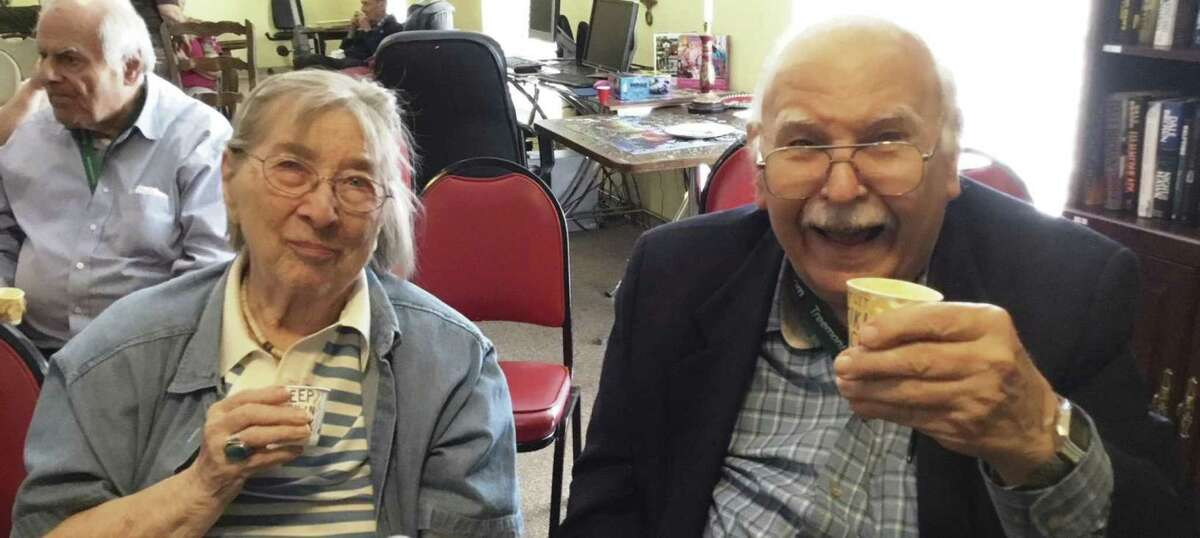 Treemont residents Fred and Marion Jenkins toast with their smoothie samples during one of the monthly nutrition seminars with Martica Heaner.