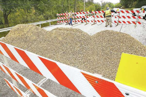 Earlier this week, workers from the Illinois Department of Transportation had piled rock up on Illinois Route 100 on the west side of Grafton to prevent motorists from driving around the barricades. Water covered the road in two places Monday inside the town of Grafton. On Friday, the road was reopened as the flood had receded to the point of uncovering the roadway.