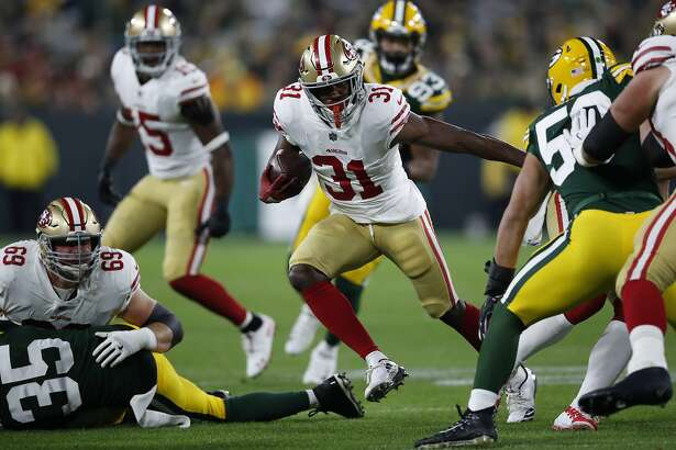 San Francisco 49ers running back Raheem Mostert (31) runs the ball against the Green Bay Packers during an NFL football game Monday, Oct. 15, 2018, in Green Bay, Wis. The Packers won 33-30. (Jeff Haynes/AP Images for Panini)