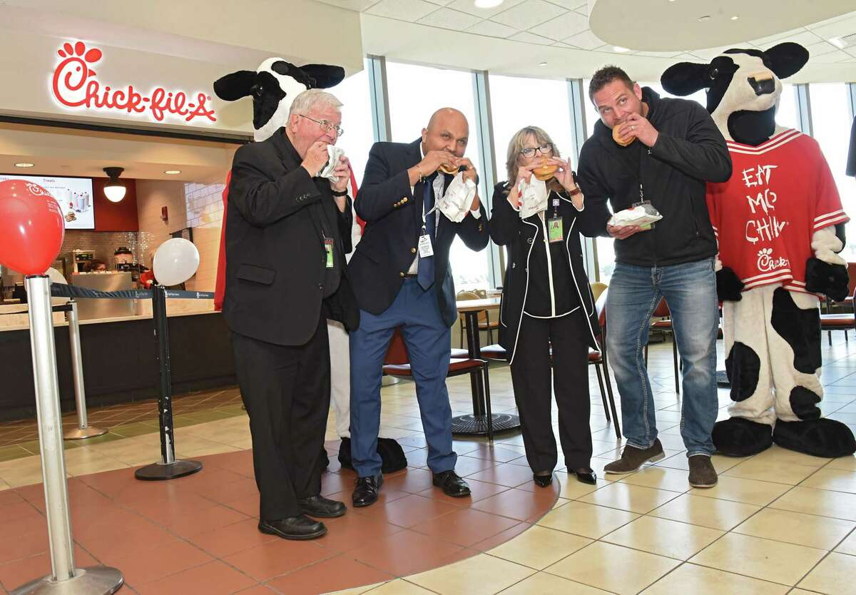The traditional first bites are taken as Albany International Airport hosts a Grand Opening Celebration for the area's first Chick-fil-A on Friday, Oct. 19, 2018 in Colonie, N.Y. (Lori Van Buren/Times Union)