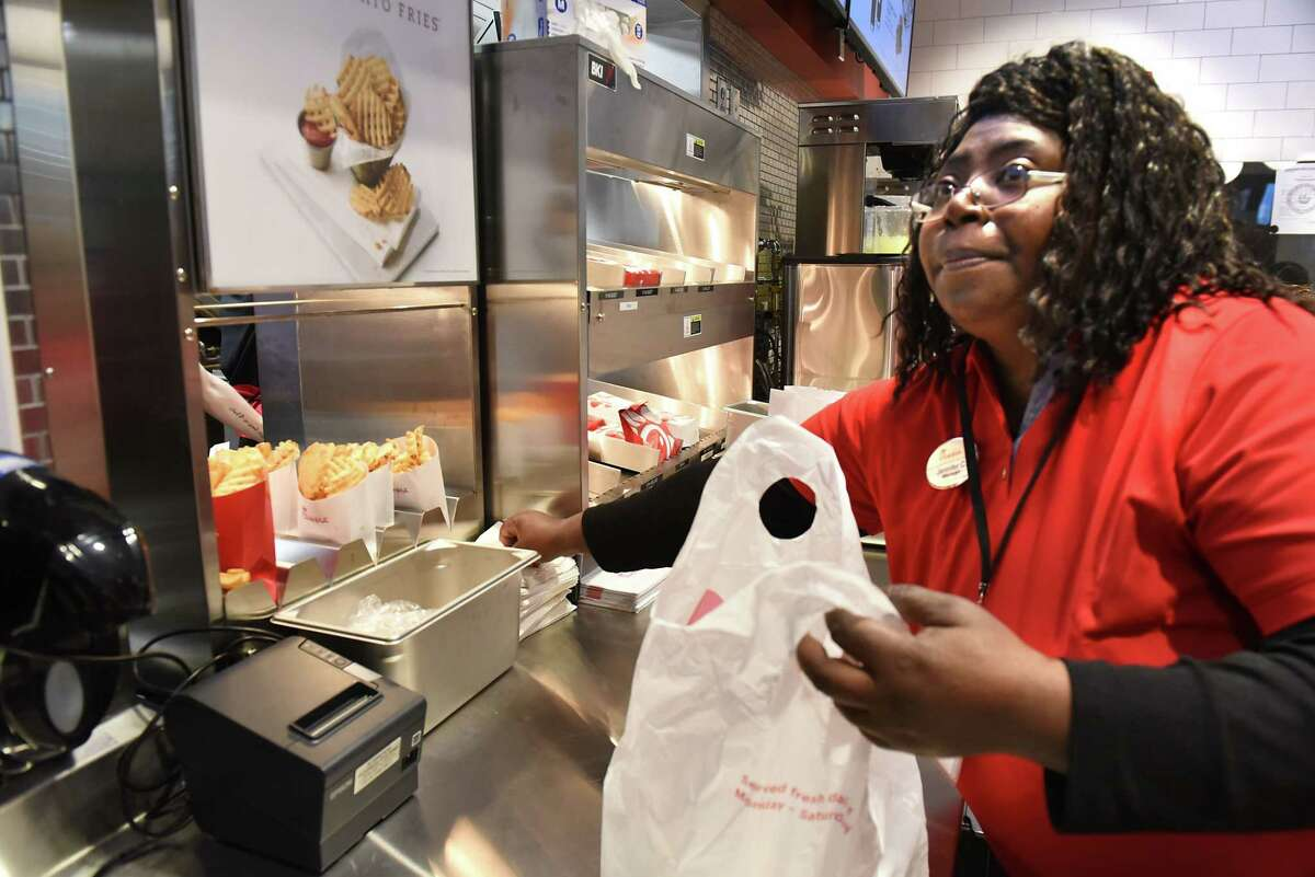 Chick-fil-A manager Jennifer Carr bags up orders as Albany International Airport hosts a Grand Opening Celebration for the area's first Chick-fil-A on Friday, Oct. 19, 2018 in Colonie, N.Y. (Lori Van Buren/Times Union)