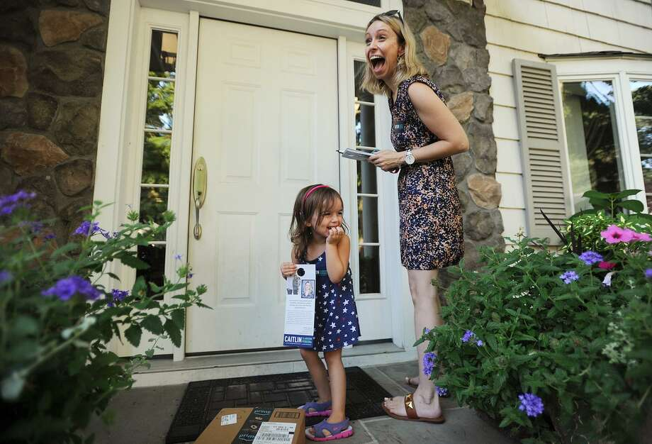 Candidate for Fairfield state representative Caitlin Clarkson Pereira and daughter, Parker,3, have a laugh as they campaign door to door on Limerick Road in Fairfield, Conn. on Wednesday, August 22, 2018. Clarkson Pereira was denied her request to the State Elections Enforcement Commission to use her campaign funds to pay for child care. Photo: Brian A. Pounds / Hearst Connecticut Media / Connecticut Post