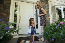Candidate for Fairfield state representative Caitlin Clarkson Pereira and daughter, Parker,3, have a laugh as they campaign door to door on Limerick Road in Fairfield, Conn. on Wednesday, August 22, 2018. Clarkson Pereira was denied her request to the State Elections Enforcement Commission to use her campaign funds to pay for child care.