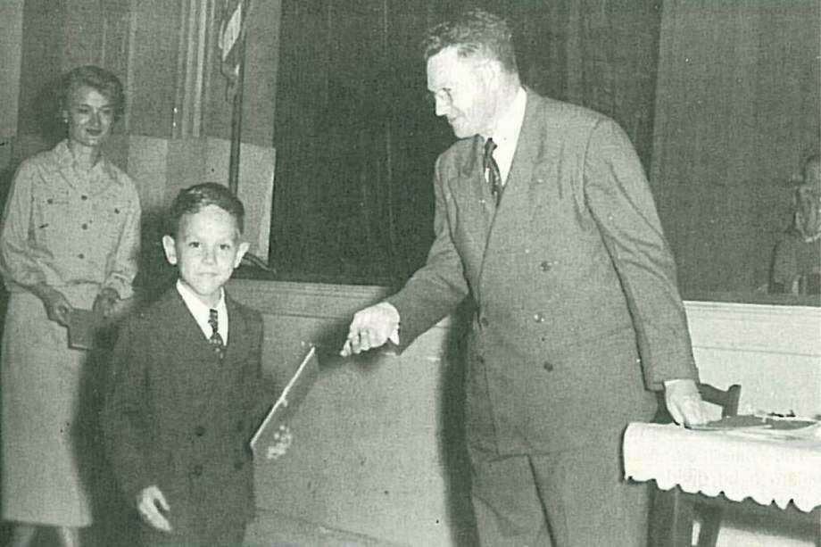 Principal B.B. Rice handing a kindergarten student his diploma at Sam Houston Elementary School in Conroe. Rice was the schools only principal from its opening in 1937 to his retirement in 1967.