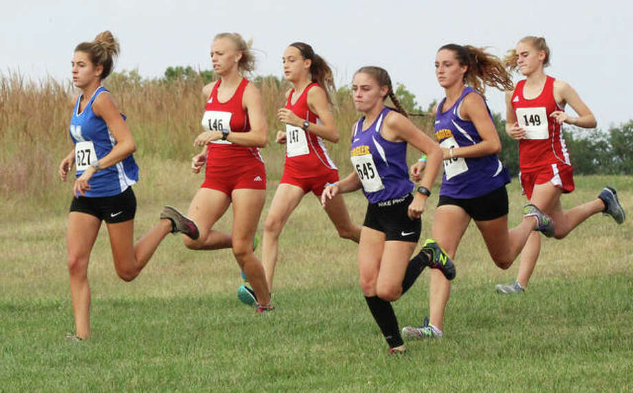 Marquette Catholic's Riley Vickrey (left) leads a pack that includes (from left) Alton's Jessica Markel and Sophia Paschall, CM's Zoey Lewis and Kati Wells and Alton's Ainsley Redman at the start of the Haven Invite earlier this season at Principia College in Edwardsville. Cross country runners throughout the state open the postseason in regional races Saturday. Photo: Greg Shashack / The Telegraph