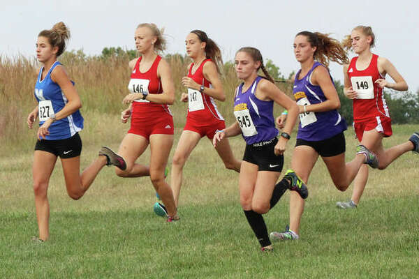 Marquette Catholic's Riley Vickrey (left) leads a pack that includes (from left) Alton's Jessica Markel and Sophia Paschall, CM's Zoey Lewis and Kati Wells and Alton's Ainsley Redman at the start of the Haven Invite earlier this season at Principia College in Edwardsville. Cross country runners throughout the state open the postseason in regional races Saturday.