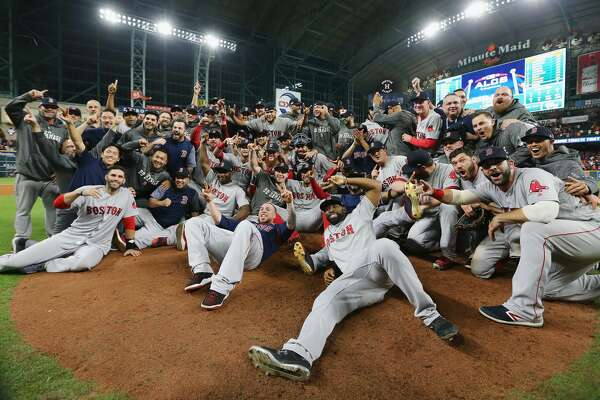 The Boston Red Sox gathered around to commemorate and cement their victory against the 2017 World Series champions, Houston Astros. (Photo by Elsa/Getty Images)