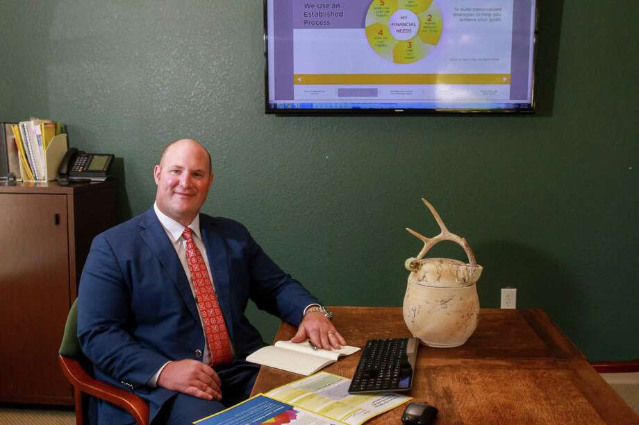 David Coney, Edward Jones Financial Advisor, in his office in Friendswood. Photo: Gary Fountain / Contributor / © 2018 Gary Fountain