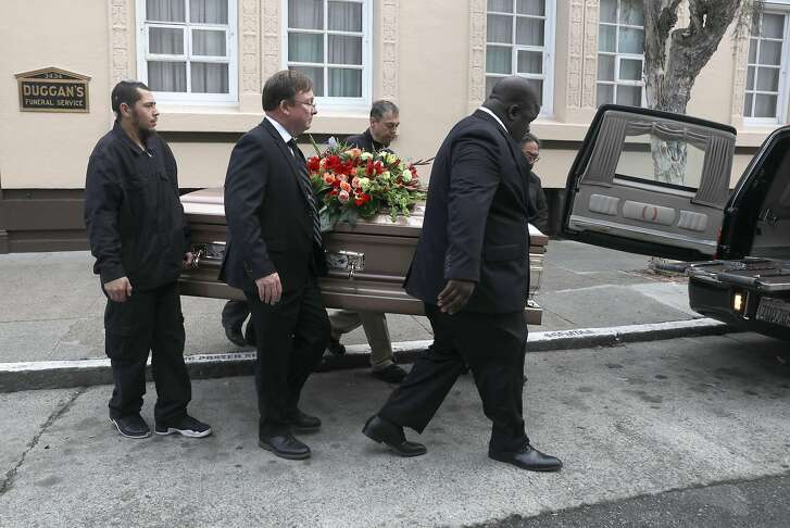 Owner Steve Welch (middle) including his staff tend to a funeral at Duggan�s funeral home on Thursday, Oct. 18, 2018, in San Francisco, Calif.  Family-owned funeral home Duggan�s celebrates its 100th anniversary.