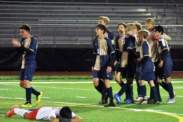 Father McGivney players celebrate after defeating Murphysboro on Wednesday in a Class 1A Belleville Althoff Sectional semifinal.