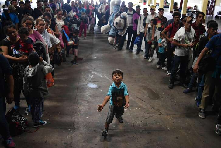 Honduran migrants taking part in a caravan towards the United States, await after arriving at the Casa del Migrante (Migrant's House) in Guatemala City on October 17, 2018. - A migrant caravan set out on October 13 from the impoverished, violence-plagued country and was headed north on the long journey through Guatemala and Mexico to the US border. President Donald Trump warned Honduras he will cut millions of dollars in aid if the group of about 2,000 migrants is allowed to reach the United States. (Photo by JOHAN ORDONEZ / AFP)JOHAN ORDONEZ/AFP/Getty Images