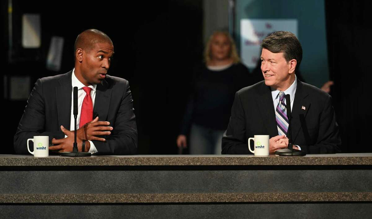 Candidates for the19th Congressional District Antonio Delgado, left and incumbent John Faso prepare for their debate at the studios of WMHT TV Friday Oct.19, 2018 in East Greenbush, N.Y. (Skip Dickstein/Times Union)