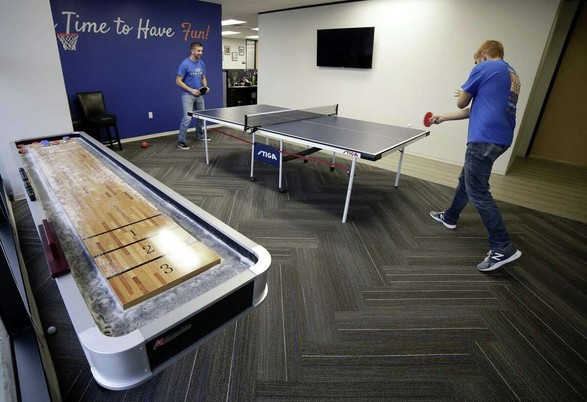 Employees Josh Delzell and Michael Casenave play ping pong in the rec room at the Venterra Realty offices Wednesday, Sep. 12, 2018 in Houston, TX.