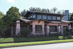 The Audubon Place home of Claire and Jeff Granberry will be one of several on the annual Good Brick Tour photographed Wednesday, Oct. 10, 2018, in Houston. Claire's grandfather built the home in 1922 with all kinds of odd things, like windows that raised and lowered on their own, a front door lock that could be operated by a switch at her grandfather's bedside and a bell that rang when mail was delivered. It's been in Claire's family for four generations.