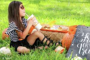 Gonzales-based JG Photography said Whataburger's orange theme inspired their latest fall photos with 4-year-old model Ashlynn. Photos shared with mySA.com show the pumpkin-colored burger wrapper and cup falls perfectly into the backdrop as the little girl snacks on her favorite food.