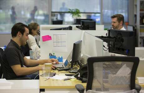 Developers work on software at the Improving - Houston office on Wednesday, Aug. 29, 2018 in Houston.