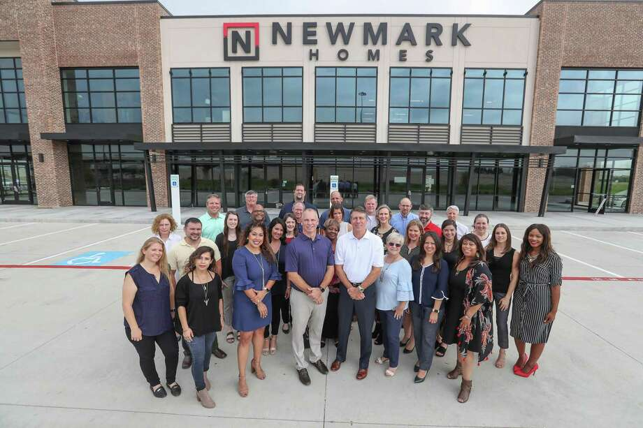Members of Newmark Homes Houston LLC pose infant of their new building located at 23033 Grand Circle Blvd., Friday, Sept. 28, 2018, in Houston. Photo: Steve Gonzales,  Houston Chronicle / Staff Photographer / © 2018 Houston Chronicle