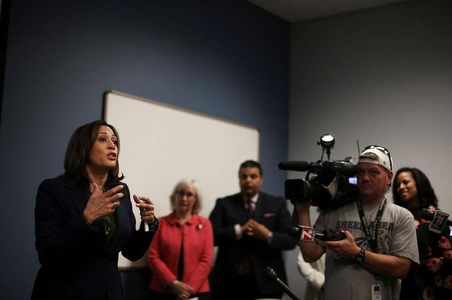 Sen. Kamala Harris (left), D-Calif., speaks to workers at a Democratic phone bank in South Carolina in a library in Greenville. The state holds a key early presidential primary. Photo: Travis Dove / New York Times