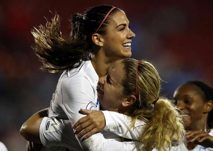 FRISCO, TX - OCTOBER 17:  (L-R) Alex Morgan #13 of the United States celebrates her goal with Lindsey Horan #9 against Canada during the CONCACAF Women's Championship final match at Toyota Stadium on October 17, 2018 in Frisco, Texas.  (Photo by Ronald Martinez/Getty Images)