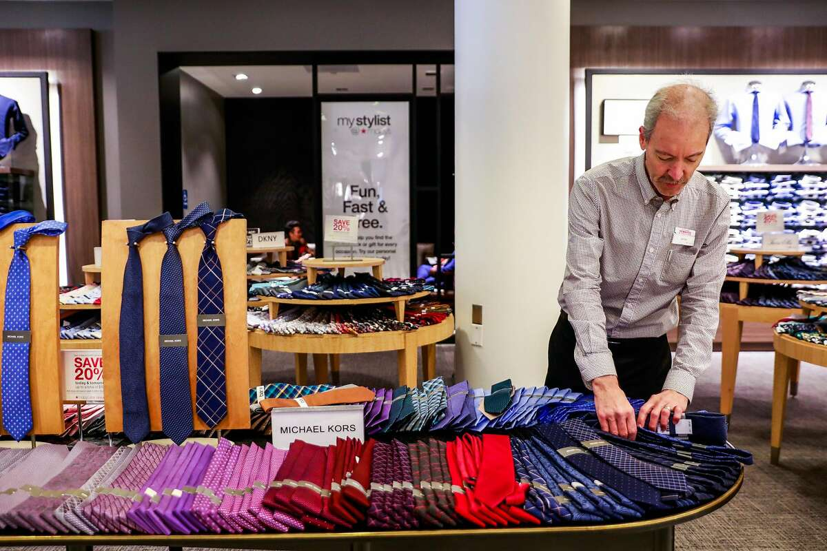 Sales colleague James McGovern organinzes ties at the Macy's store in San Francisco, California, on Tuesday, Oct. 16, 2018.