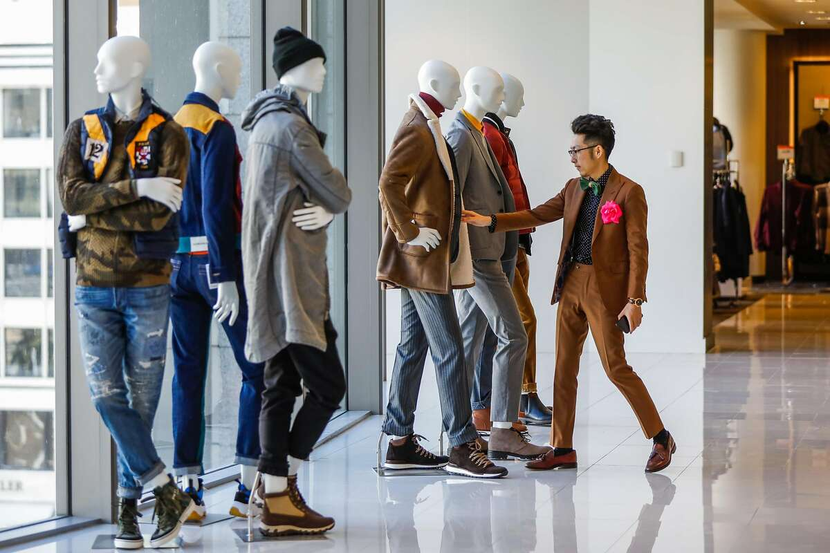 Daniel Ni the mystylist at Macy�s checks out the mannequin's on display in San Francisco, California, on Tuesday, Oct. 16, 2018.