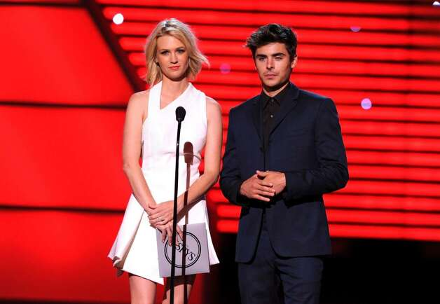 LOS ANGELES, CA - JULY 14:  Actress January Jones and actor Zac Efron present onstage during the 2010 ESPY Awards at Nokia Theatre L.A. Live on July 14, 2010 in Los Angeles, California.  (Photo by Kevin Winter/Getty Images) *** Local Caption *** January Jones;Zac Efron present Photo: Kevin Winter, Getty Images / 2010 Getty Images