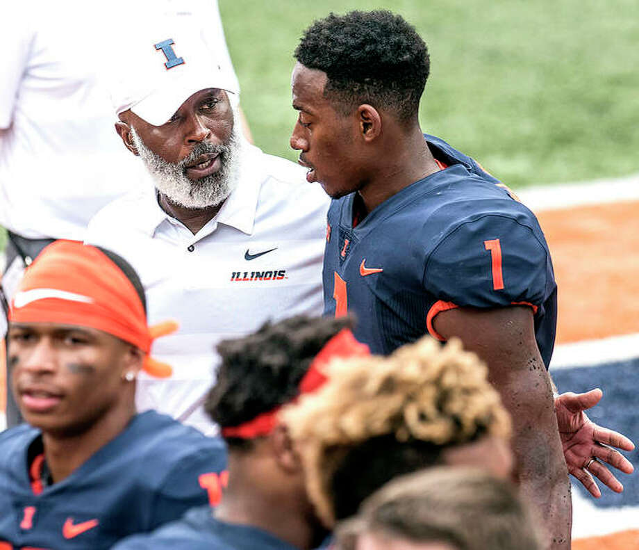 Illinois head coach Lovie Smith gives his quarterback A.J. Bush a pat on the back after a game against Kent State in Champaign. Wisconsin had had trouble against running quarterbacks, and their secondary is hampered by injuries. The mobile Bush, who has rushed for three scores over two games since returning from a hamstring injury, may have to wreak havoc in order for the Illini to have a chance at keeping the game close on Saturday in Madison, Wisc. Photo: AP Photo