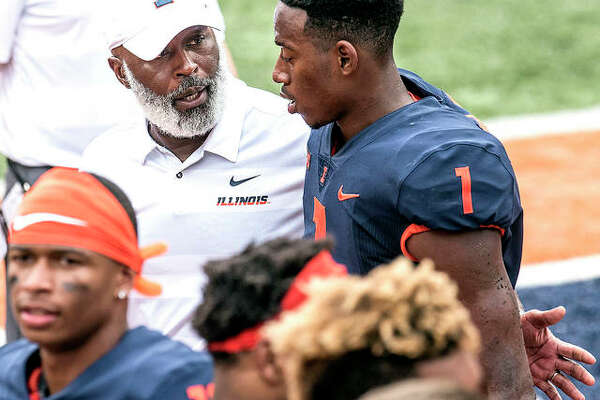 Illinois head coach Lovie Smith gives his quarterback A.J. Bush a pat on the back after a game against Kent State in Champaign. Wisconsin had had trouble against running quarterbacks, and their secondary is hampered by injuries. The mobile Bush, who has rushed for three scores over two games since returning from a hamstring injury, may have to wreak havoc in order for the Illini to have a chance at keeping the game close on Saturday in Madison, Wisc.