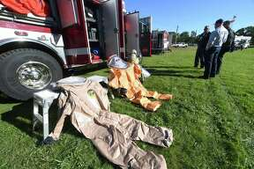 The Milford Fire Department displays hazardous materials suits at the CT Department of Emergency Management and Homeland Security Region 2 Field Day at the North Haven Fairgrounds on October 19, 2018.