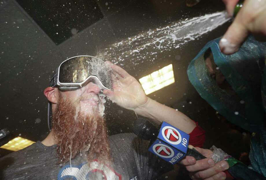 Boston Red Sox relief pitcher Craig Kimbrel celebrates in the locker room after winning the baseball American League Championship Series against the Houston Astros on Thursday, Oct. 18, 2018, in Houston. Red Sox won 4-1. (AP Photo/David J. Phillip) Photo: David J. Phillip, Associated Press / Copyright 2018 The Associated Press. All rights reserved