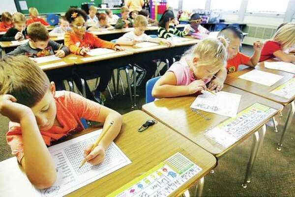 This 2016 file photo shows second grade students diligently at work at Lewis and Clark Elementary School in Wood River.