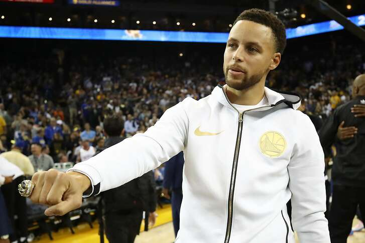 OAKLAND, CA - OCTOBER 16: Stephen Curry #30 of the Golden State Warriors shows his 2017-2018 Championship ring prior to their game against the Oklahoma City Thunder at ORACLE Arena on October 16, 2018 in Oakland, California. NOTE TO USER: User expressly acknowledges and agrees that, by downloading and or using this photograph, User is consenting to the terms and conditions of the Getty Images License Agreement. (Photo by Ezra Shaw/Getty Images)