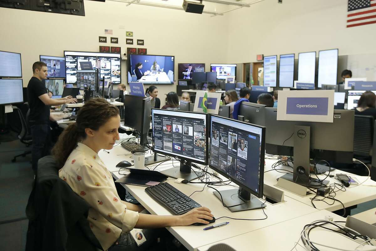 Lexi Sturdy, election war room lead, sits at her desk during a demonstration in the war room, where Facebook monitors election related content on the platform, in Menlo Park, Calif., Wednesday, Oct. 17, 2018. (AP Photo/Jeff Chiu)