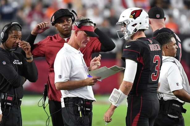 GLENDALE, AZ - OCTOBER 18: Offensive coordinator Mike McCoy (front), quarterbacks coach Byron Leftwich and head coach Steve Wilks talk with quarterback Josh Rosen #3 of the Arizona Cardinals during the second half against the Denver Broncos at State Farm Stadium on October 18, 2018 in Glendale, Arizona.