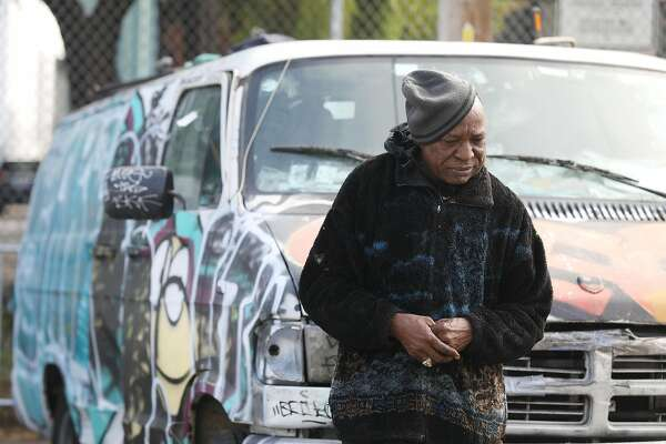 Oscar Lewis Williamson leans against his van along San Bruno Avenue on Thursday, October 18, 2018 in San Francisco, Calif. Available parking spaces are one of the issues that Williamson feels would help the homeless.