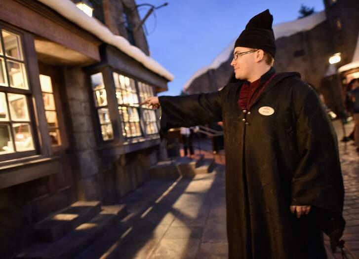 A guest casts a spell at the opening of the Wizarding World of Harry Potter at Universal Studios Hollywood in 2016.