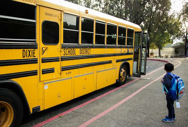 A student pauses after getting off of the school bus at Dixie Elementary School in San Rafael, California, on Thursday, Oct. 18, 2018.