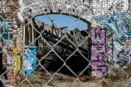 An abandoned roundhouse at the former rail yard and landfill called the Baylands in Brisbane would be redeveloped under Measure JJ, which would also allow up to 2,200 housing units. Photo: Amy Osborne / Special To The Chronicle