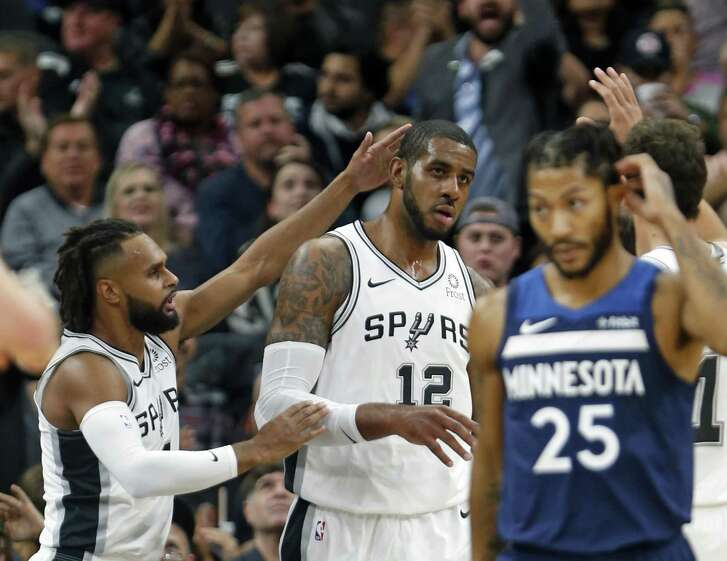 SAN ANTONIO,TX - OCTOBER 17 : Patty Mills #8 of the San Antonio Spurs congratulates LaMarcus Aldridge #12 of the San Antonio Spurs after a basket against the Minnesota Timberwolves in season opener at AT&T Center on October 17 , 2018 in San Antonio, Texas. NOTE TO USER: User expressly acknowledges and agrees that , by downloading and or using this photograph, User is consenting to the terms and conditions of the Getty Images License Agreement. (Photo by Ronald Cortes/Getty Images)